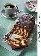Homemade Kalter Hund cake on blue table