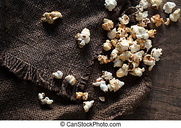 Homemade Kettle Corn Popcorn on wooden rustic table with...