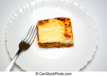 homemade lasagne on a white plate