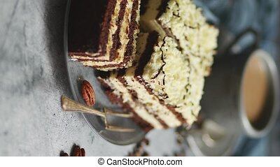 Homemade layered cake sprinkled with white chocolate. Served...