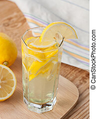 Homemade lemonade in a glass - Lemon drink in a glass and ...