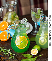 Homemade lemonade with citruces on the table