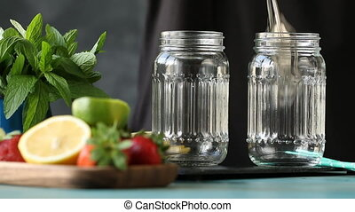 Homemade lemonade with lemon ,lime,mint and ice cubes on black background