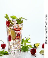Homemade lemonade with strawberries, lime and mint