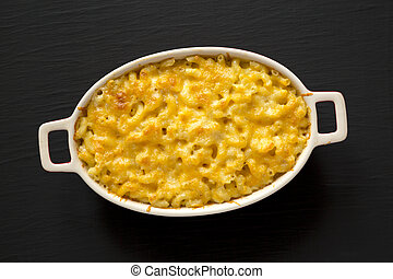 Homemade Macaroni and Cheese Pasta on a black background, top view. Flat lay, overhead, from above.