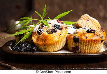Homemade marijuana muffins with berry fruit