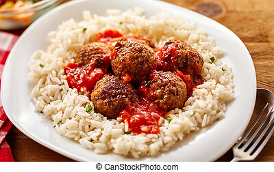 Homemade Meal of Saucy Meatballs on a Bed of Rice
