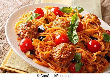 Homemade meat balls with spaghetti, aubergines and tomatoes close-up. horizontal