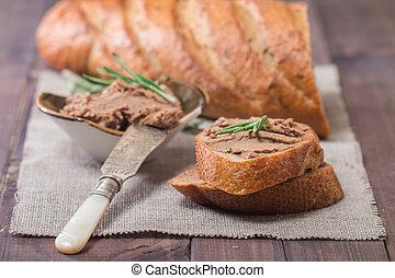 Homemade meat snack liver pate with toast on rustic...