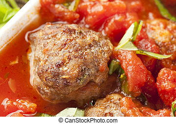 Homemade Meatballs in Red Tomato Sauce on a background