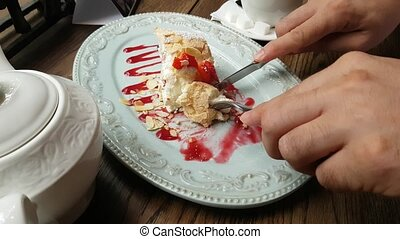 Homemade Meringue Cake with blueberries and raspberry jam