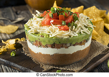 Homemade Mexican 7 Layer Dip with Beans, Sour Cream and...