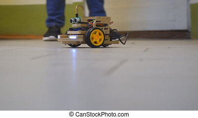 Homemade model cars rides on the floor. Designs the model of...