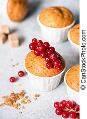 Homemade muffins in white paper cups