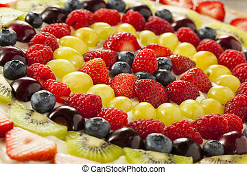 Homemade Natural Fruit Pizza with Frosting and Berries
