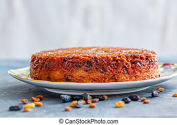 Homemade noodle Kugel in sugar caramel. - Dish with...