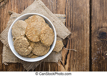 Homemade Oat Cookies on wooden background (close-up shot)
