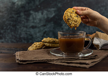 Homemade oatmeal cookies with a cup of cocoa