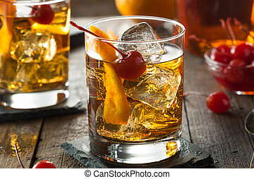 Homemade Old Fashioned Cocktail with Cherries and Orange...