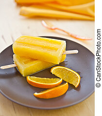 Homemade Orange ice popsicles