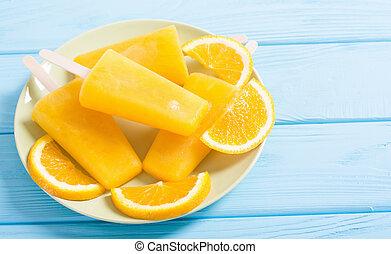 Homemade orange popsicle