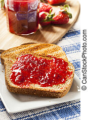 Homemade Organic Red Strawberry Jelly on toast - Homemade...