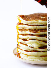 homemade pancakes pile on a plate for breakfast