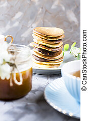 Homemade pancakes stacked on a gray background