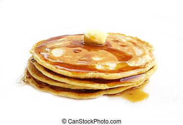 Homemade pancakes with butter and maple syrup on white...