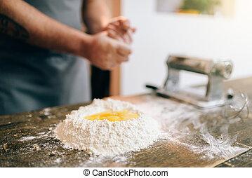Homemade pasta cooking, male chef preparing dough