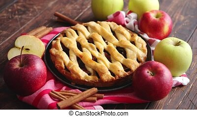 Homemade pastry apple pie with bakery products on dark ...