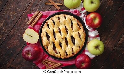 Homemade pastry apple pie with bakery products on dark...