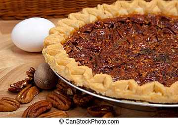 Homemade pecan pie with ingredients