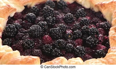 Homemade pie closeup on blackberries.