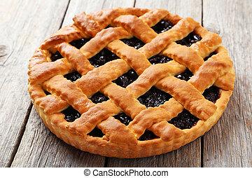 Homemade pie on grey wooden background