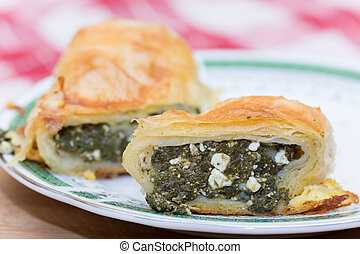 Homemade pie with spinach on a plate