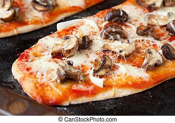 homemade pizza with mushrooms and mozzarella
