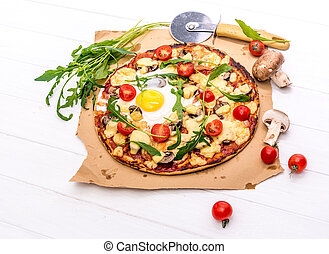 homemade pizza with mushrooms and rucola