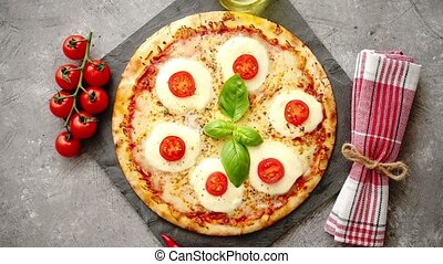 Homemade pizza with tomatoes, mozzarella and basil. Top view...