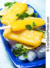 Homemade popsicles with lemon and mint