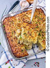 Homemade potato kugel is a dish of jewish cuisine. - Piece...