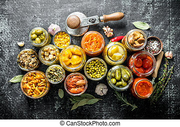 Homemade preserved food in jars.