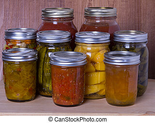 Group of homemade preserved vegetables and fruits