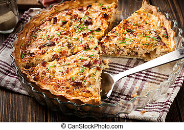 Homemade quiche lorraine with bacon and cheese