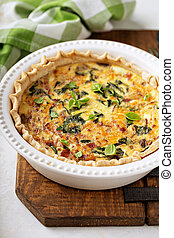 Homemade quiche with bacon and spinach