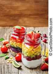 homemade rainbow salads with vegetables, quinoa, Greek yogurt and fruit