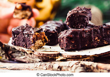 Homemade raw chocolate candy snickers bars. Tone. - Homemade...