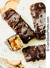 Homemade raw chocolate candy snickers bars. Vegan dessert....