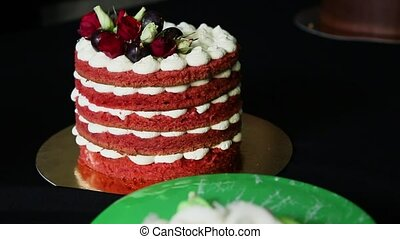 homemade red cake with bizet, grapes and roses - homemade...