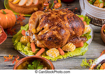 Homemade roasted turkey with other dishes .Thanksgiving Day.